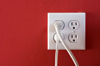 electric outlet on a red painted wall